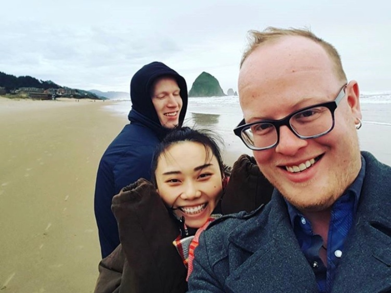 Yi, her husband, and her brother in law Simon at the beach. Simon died unexpectedly from a brain aneurysm while living with them. This loss and journey through grief has changed their lives.